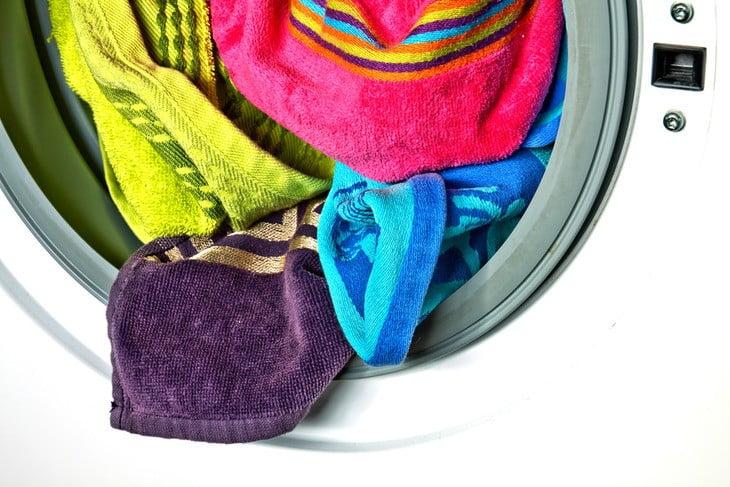 Laundry in a washing machine needing repair