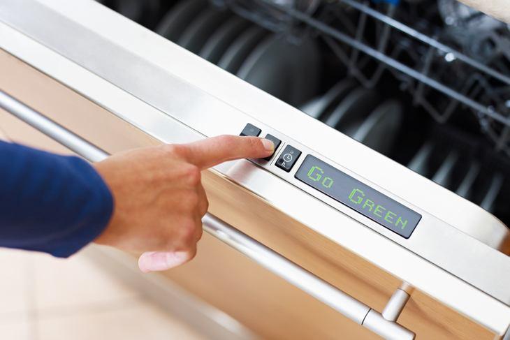 Go green dishwasher button representing eco friendly repairs